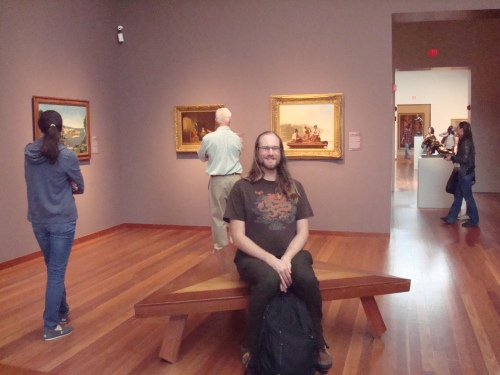 The de Young Museum in SF has seats. They're not even kind of comfortable for TWP (the seat area actually slopes downward and it's slick), but it's a seat.  That's my friend Vytas.